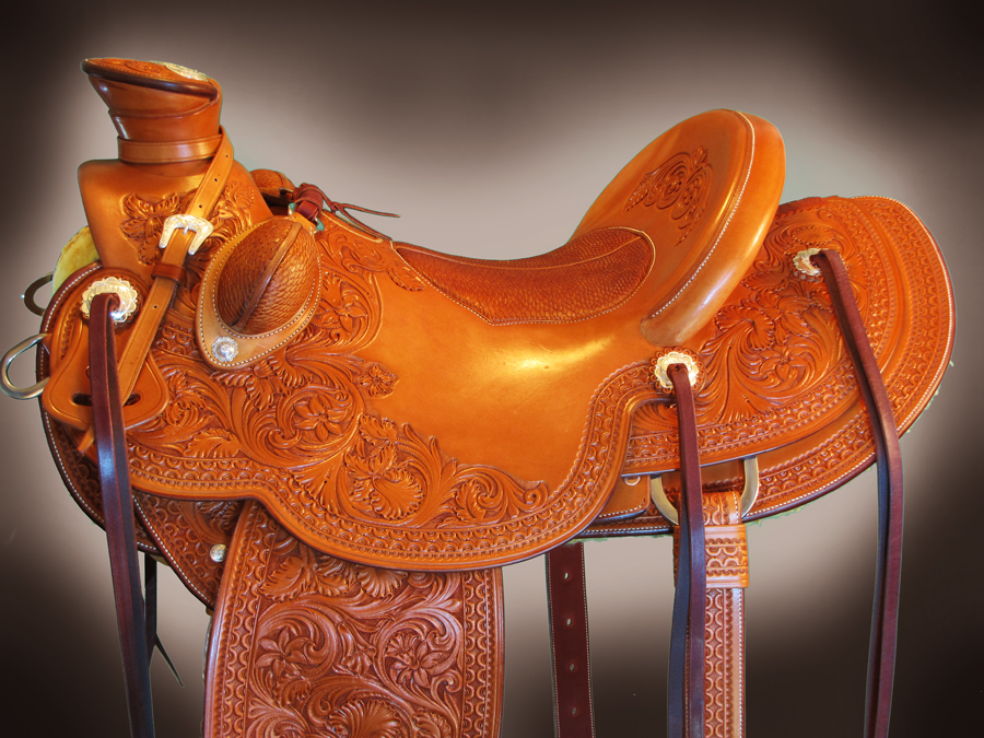 Finished saddle, beaver tail bucking rolls and matching seat.